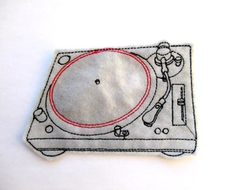 Turntable iron on patch applique in grey felt with black and red embroidery thread