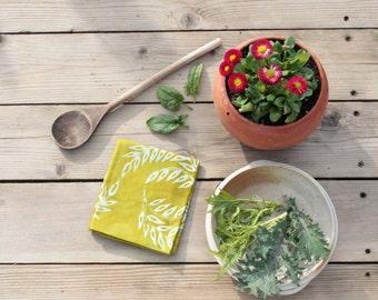 moss green linen tea towel. wheat batik print