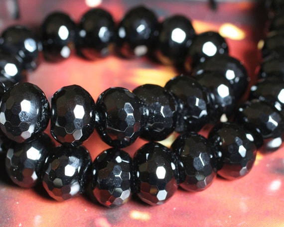 Black onyx faceted large rondelle 14mm in diameter 10mm thick, 12 pcs (item ID L07BOFRN14)