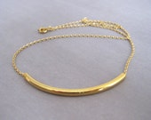 Simple gold tube necklace