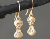 Double Baby Skull Earrings in 14K Gold with Diamonds