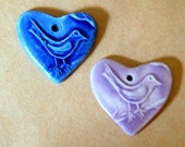2 Sweet Ceramic Bird in a  Heart Pendant Beads - 1 blue and 1 lavender