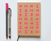 neon pink screenprinted sketchbook or notebook journal, geometric triangle design