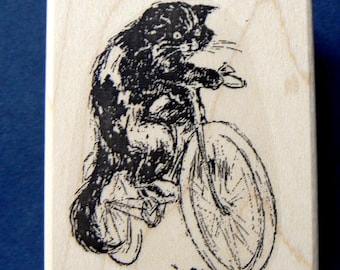 Cat on bicycle rubber stamp WM P37