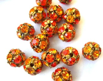 2 Vintage SWAROVSKI BEADS 10mm, orange shades crystals in brass setting creating ball bead