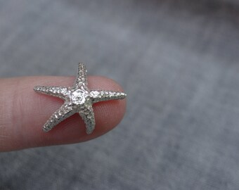 Dancing silver starfish earrings