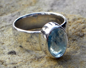 Sterling silver ring with blue aquamarine cabochon