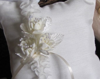 Aubray, a ring pillow in shades of ivory with ruffles ,flowers and pearls