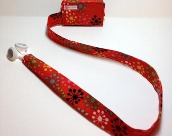 Orange atomic starburst TuneTube.  Earbud cord organizer for iPhone or iPod.  Cord keeper.  Earbud holder.  Earbud case.