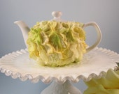 White Teapot with Yellow Faux Flower Petals