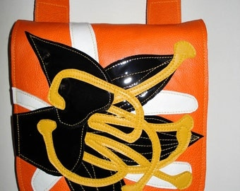 Handmade Square Bag in bright orange leather with black patent and yellow appliqued Lily