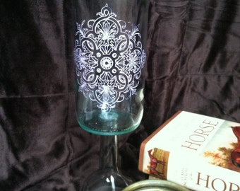 Upcycled wine bottle candle holder. Light purple silk screen design on clear glass.