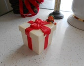1985 Hallmark Small Hard Plastic Christmas Box with Elf Pixie hanging off a red bow