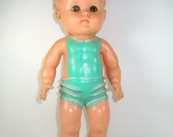Sun Rubber Squeeze Doll, Child's Toy, Green Clothes, Mid Century, 1956  (140-13)