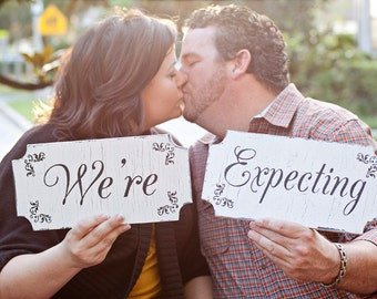 WE'RE EXPECTING baby announcement signs 12x6 Set of 2