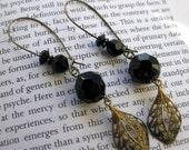 ON SALE . Feminine flirty long black faceted black glass and brass earrings