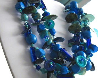 Blue long necklace. PRIMA. Mixed Media Collage Style. turquoises and blues. Multi strand look