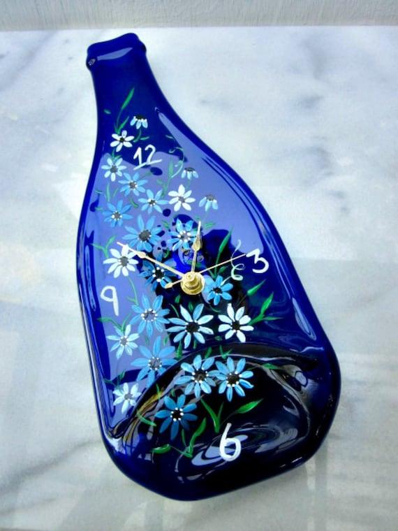 Wine bottle clock blue wine bottle melted hand - How do you melt glass bottles ...