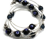 Steel Coil Wrap Bracelet with Black Glass Evil Eye Beads and Pewter Beads - anjalicreations