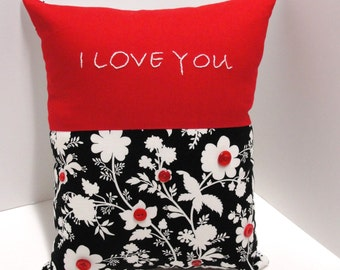 I love you pillow- hand embroidered on red with silhouette cream and black floral, red buttons