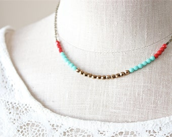 Multi color Czech glass beaded necklace.  Golden bronze turquoise and red petite beads.