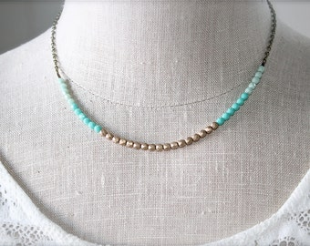 Mint green turquoise and matte gold strand necklace.  Czech glass beads.  Dainty and petite.