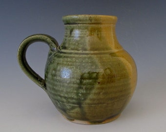 Mug or Vase.  Light & Dark Olive Green, Greenish Gold.  Stylized Form
