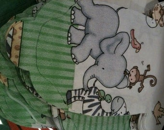 Set of 30 Baby shower shirt shaped napkins.  Doubles as a banner decoration. Features cute jungle animals.