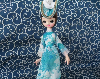 Vintage Big Eyed Pose Doll in Blue Flowered Dress Still with her Package