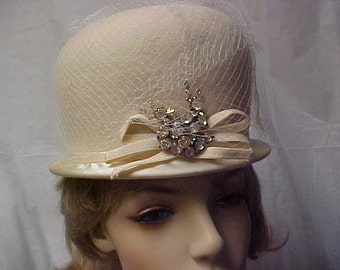 SALE.   Beige wool cloche hat with rhinestone-netting- designer label- union label - fits 21 inch