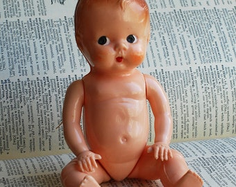 vintage Lucite or Bakelite doll... Jan 07