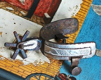 a pair of antique cowboys spurs...   HOME DECOR...   T3   L