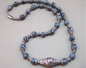 """Snowflake Obsidian Bead Necklace with silver bead caps, silver bicone focal bead and silver spacer beads 24"""""""