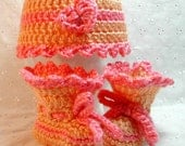 Crochet baby cap and booties set in melon and pink for newborn