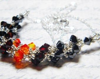 "Supernatural inspired Crowley Swarovski Crystal Necklace Hematite Fire Opal Galvanized Metallic Silver -  ""King of Hellfire"""