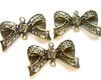 8 Antique bronze bow jewelry connectors filigree bow charm dangles 17mm x 29mm ZXA215
