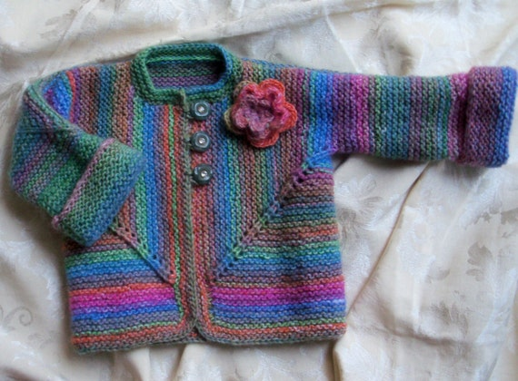 Handknit cardigan with self-striping yarn, crochet flower and vintage buttons size 2 - 4