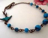 Blue sky -- turquoised stone with antique patina blue bird bracelet
