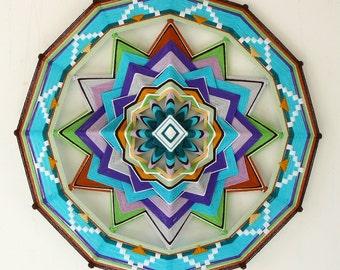 Unfolding, a custom order 24 inch Ojo de Dios mandala reserved for  Nikki Siegel