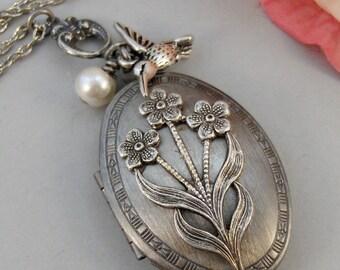 Hummingbird Bouquet,Locket,Silver Locket,Flower,Bird,Bouquet,Ivory,Antique Locket,Floral,Jewelry. Handmade jewelry by valleygirldesigns.