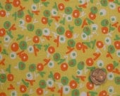 Vintage yellow fabric with orange white and green flowers 60s
