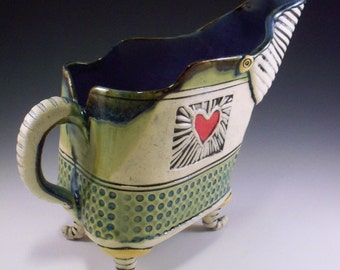 gravy boat with two hearts