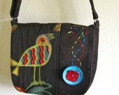 handbag with bird pattern in black, red and turquiose