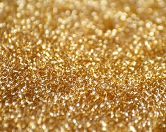 10 grams of 11/0 sized Transparent Light Topaz TOHO seed beads (TH138)