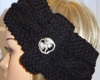 Black, headband/earwarmer, hand knitted in a cable stitch pattern, acrylic yarn with a designer silver button