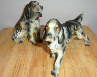 porcelain pointing  dogs figures  one sitting  and one pointing   spaniel older pieces