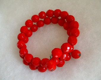 RED BRACELET. Faceted. Glass Bead. Wire Coil. vintage 1950s