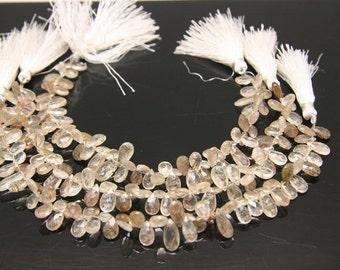 1/2strand - natural golden rutilated quartz faceted pear