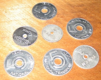 Seven Vintage English National Transport Tokens