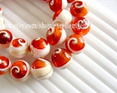 Full strand Sea shell beads in orange color - 29pcs